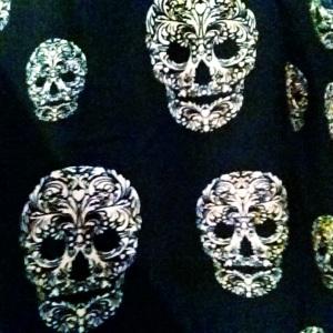 H&M skirt: Dipped hem skirt with all-over skull print.